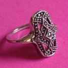 Silver tone ring size 6. Pressed metal fancy design.