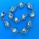"Sterling silver link bracelet. 11 glass eye balls, 8"" long - so different. Fun !"