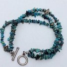 "Turquoise bracelet - 3 strand polished pieces 8 3/4"" unmarked silver toggle."