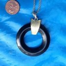 "Plastic pendant necklace, lightweight - swirled cream  & black  18"" x 1 3/4"" diameter."