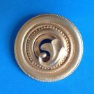 "Gold tone circle pin with satin finish  @ 2 1/8"" in diameter""."