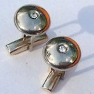 """Cuff links, shiny gold tone with clear stone center. 5/8"""" diameter."""