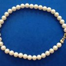 "Pearl necklace strand of 1/2"" diameter faux white pearls with gold tone clasp. Classic."