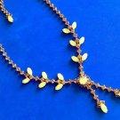Necklace - yellow glass moonstone-like & amber rhinestone dangle.