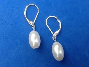 White faux pearl silver tone lever back hanging pierced earrings.