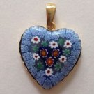 Beautiful millifiori glass heart shaped pendant set in gold over sterling.