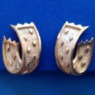 Vintage Crown Trifari textured gold tone clip on earrings.