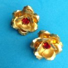 Vintage gold tone red stone roses screw on earrings.