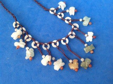 """Necklace - 11 dangling jade? animals on adjustable cord, up to 30"""" long. Magnificent !"""