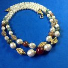 2 strand necklace. Pearl, gold tone,  greens, reds & blues costume beads.