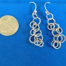 """Dangle pierced earrings. 2"""" long connected circles, very classy."""