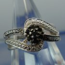 RING sz 7 sterling 925 silver with a couple of BLACK and WHITE DIAMONDS