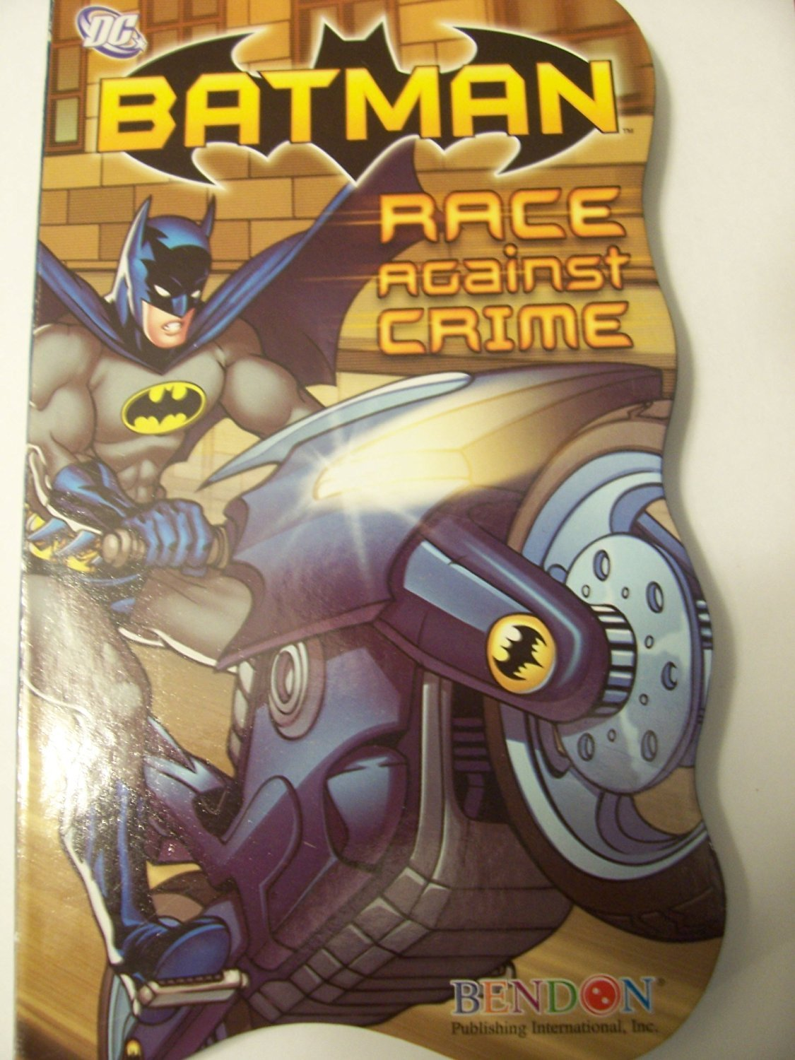 DC Comics Batman Shaped Board Book ~ Race Against Crime  Board book.