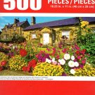 Cra-Z-Art A Summer View of Denwick Village and Gardens with Flowers in Full Bloom - 500 Piece