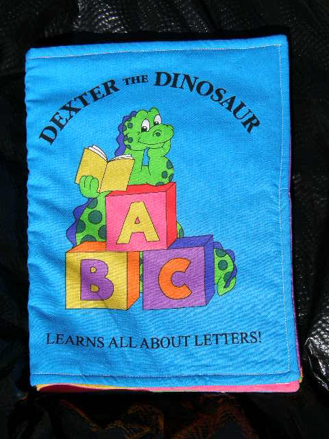"$20.50 Cloth Book 7X10-""Dexter The Dinosaur Learns All About  Letters"" 10 Pages-Machine Washable"