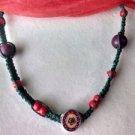 Green Hemp Necklace w/ Red & Purple Beads, Flower Pendant