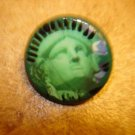 Old metal button with Statue of Liberty head.
