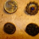 Lot of 4 antique picture buttons peackock eye & other.