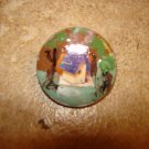 Pretty as picture lucite button with bird house.