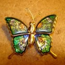 Gold metal and green cloisonne button in shape of butterfly.