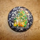 Beautiful Christmas button with Christmas tree and snowflakes.