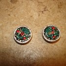Two silver metal buttons with Christmas holly.