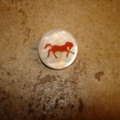 Mother of pearl button with red horse.