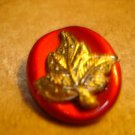 Beautiful large oval button with gold metal leaf.
