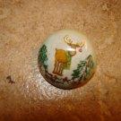 Dome shape Christmas button with moose and Christmas tree.