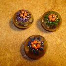 Set of 3 old dome shape silver metal buttons with flowers.