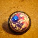 Art nouveau style plastic button with blue rhinestone.