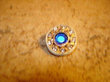 Beatiful gold tone metal button with large blue rhinestone