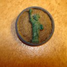 Metal button with Statue of Liberty.