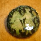 Paper mache button with European dancers signed by artist.
