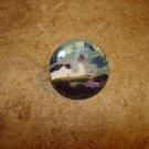 Pretty as picture mother of pearl button with lighthouse.