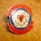 Augustana Lutheran all metal pin back pin.