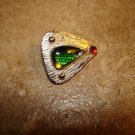 Triangle shape silver metal button with green and red stone.