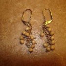 Vintage gold metal earings with wooden beads.