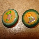Set of 2 Christmas buttons with Christmas stocking and candle.