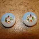 Set of 2 Christmas buttons with snowman and Christmas wreath.