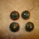 Set of 4 nicely painted metal buttons.