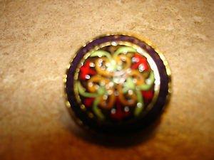 Vintage metal button with painted art nouveau patern.