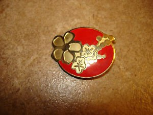 Large gold metal button with red & gold flower.