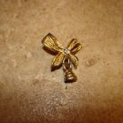 Gold metal ribbon button with bell and rhinestone.