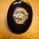 Large oval shape faux tortoisse shell button with Noah's arc.