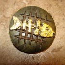 Large carved hard plastic button with gold metal fish skeleton.