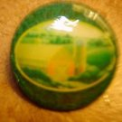 Large plastic button with country barn picture.
