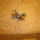 Gold metal pin back pin cheetah with tiny rhinestones.