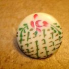 Large plastic button with Japanese style paintings.
