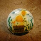 Large plastic button with picture like mushroom & floral garden.